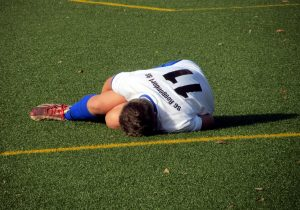 soccer player injured on the ground