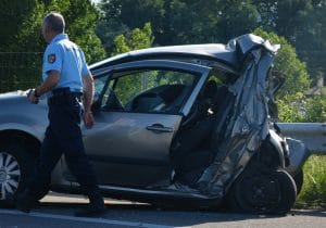 officer on the site of a car crash