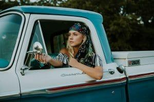 hippie teen driving a classic truck