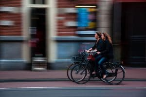 blurry image of women riding bikes