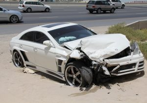 car collision on the side of the road in sand