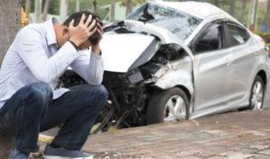 car crash and a man with headache, car accident