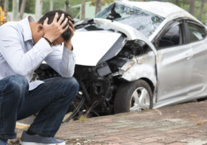 car crash and a man with headache, car accident